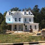 white brick home under construction