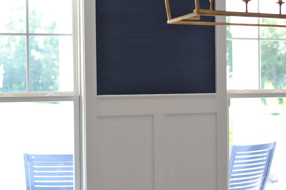 very closeup shot of the navy grasscloth wallpaper