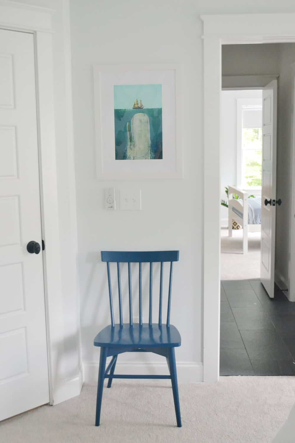 chair with art in boys room