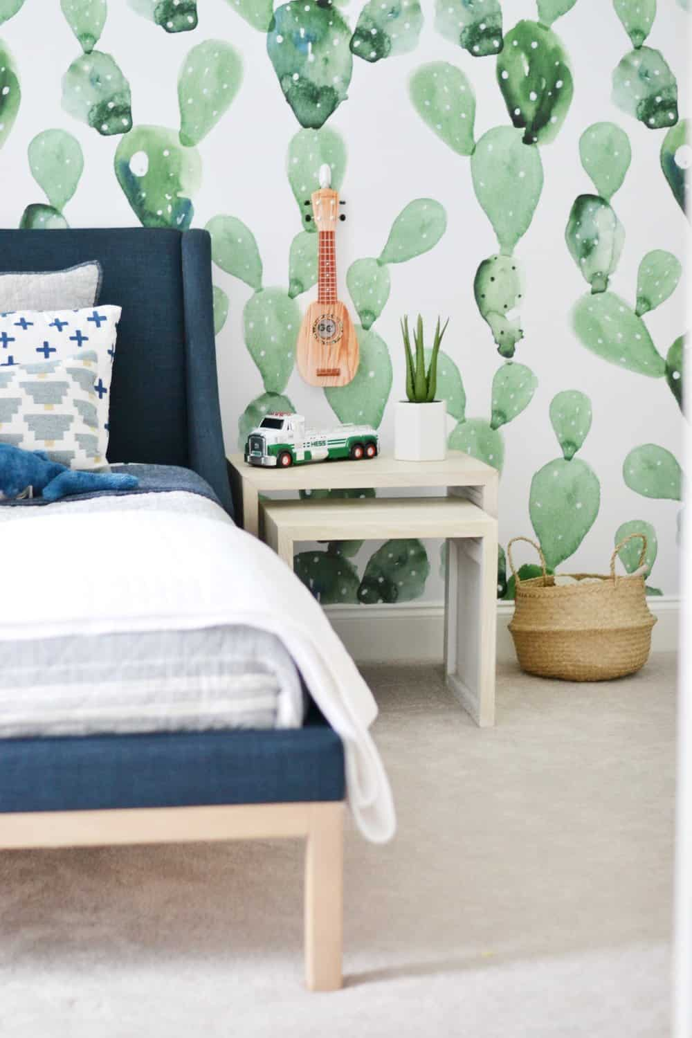 cactus removable wallpaper with a navy blue bed in bedroom