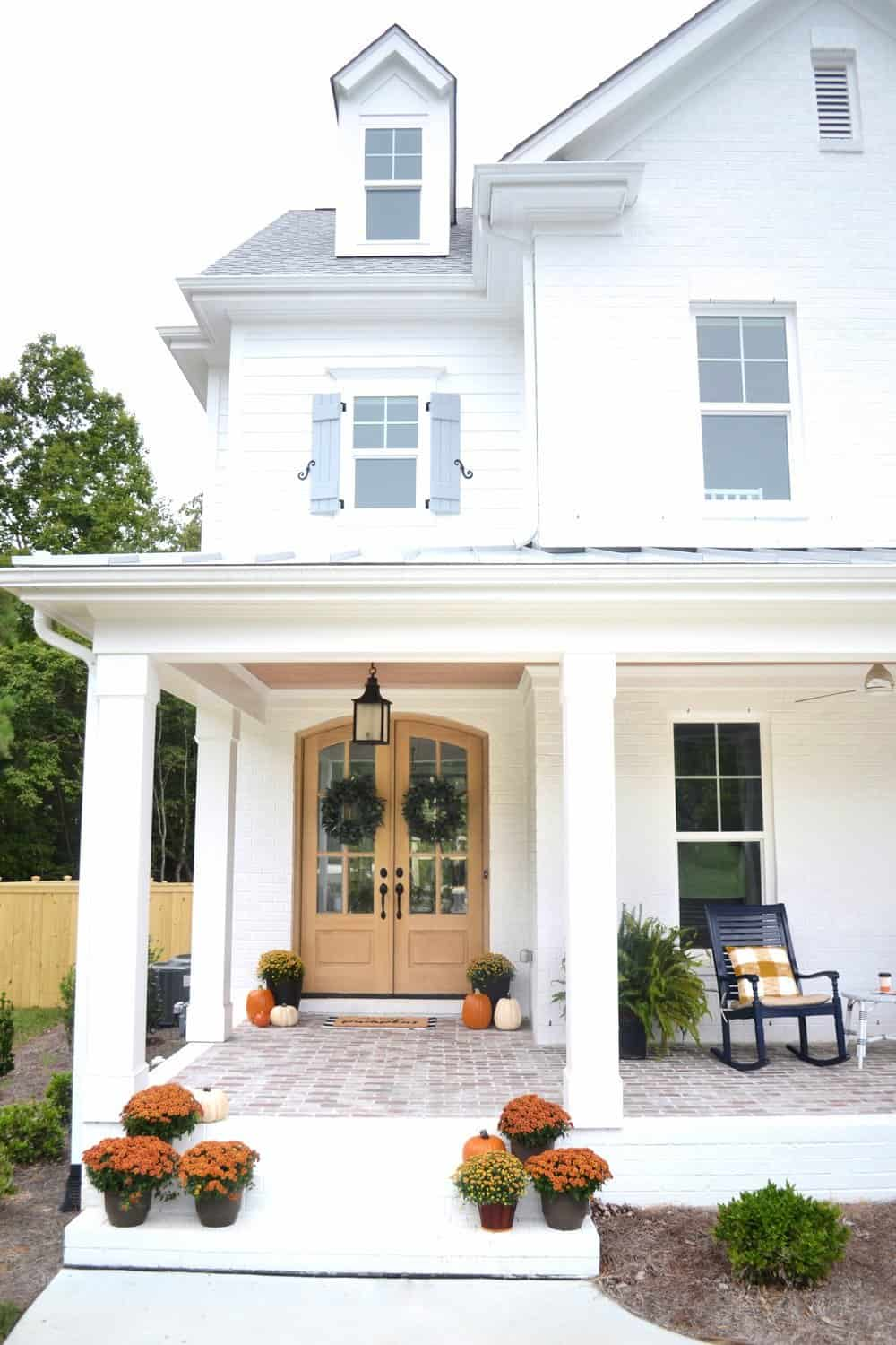 white brick exterior and a fall front porch