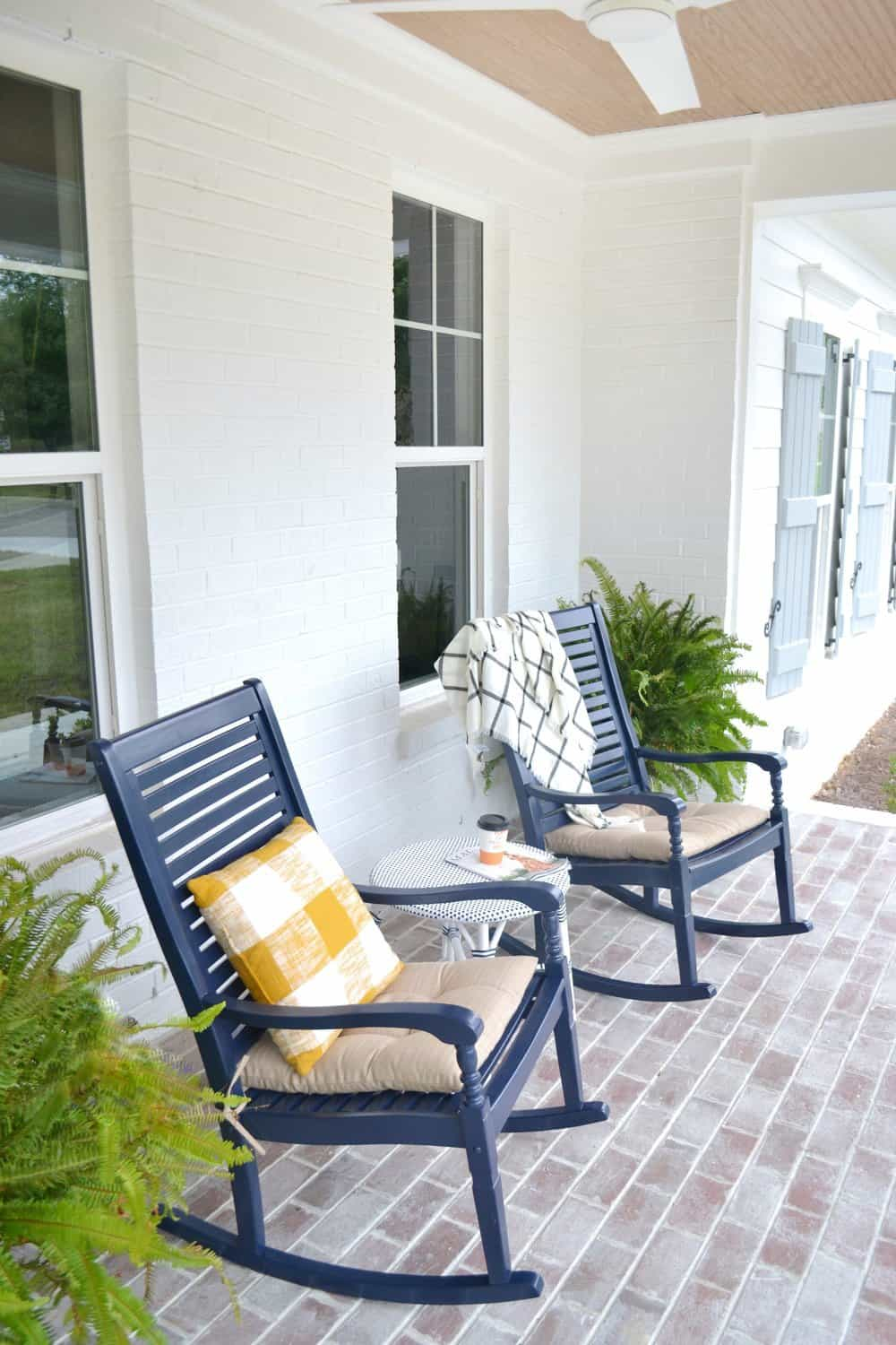 rocking chairs and a yellow pillow