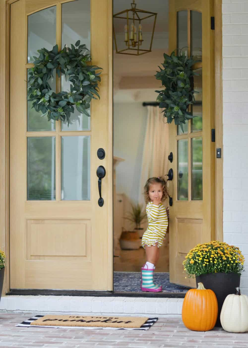 little girls and big double front porch doors