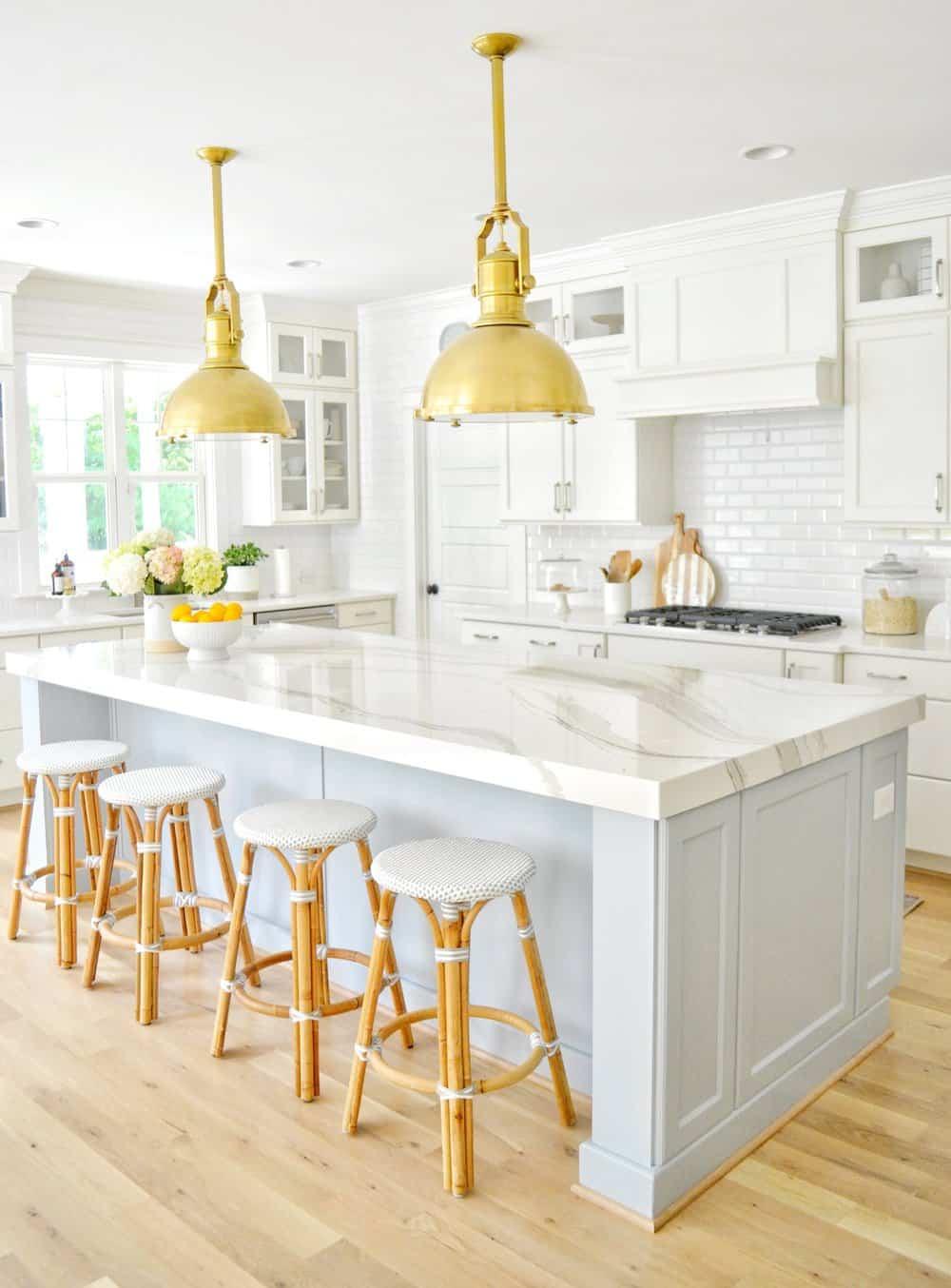 Serena and lily bar stools lined up at a kitchen island