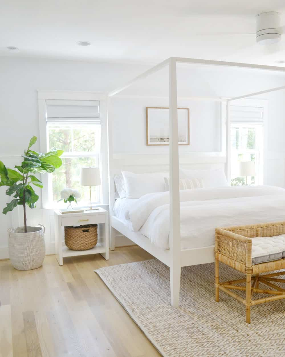 master bedroom with canopy bed, shore bench, dauphine light
