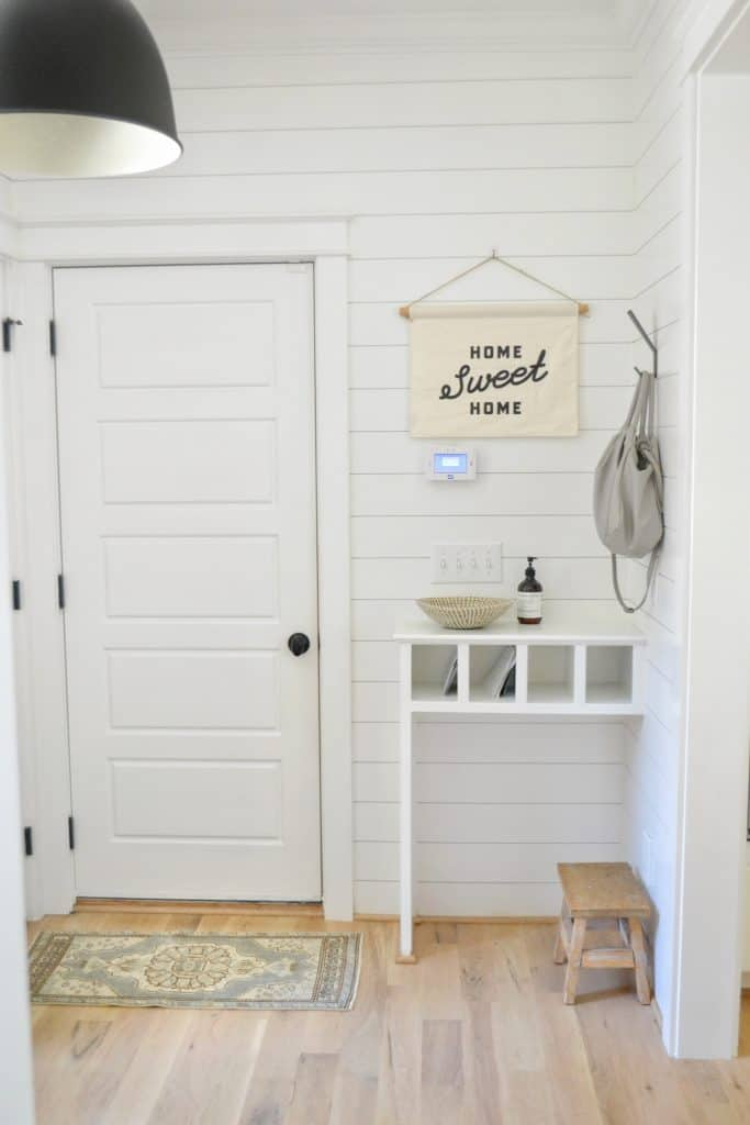 mudroom with a black light and a diy mail organizer