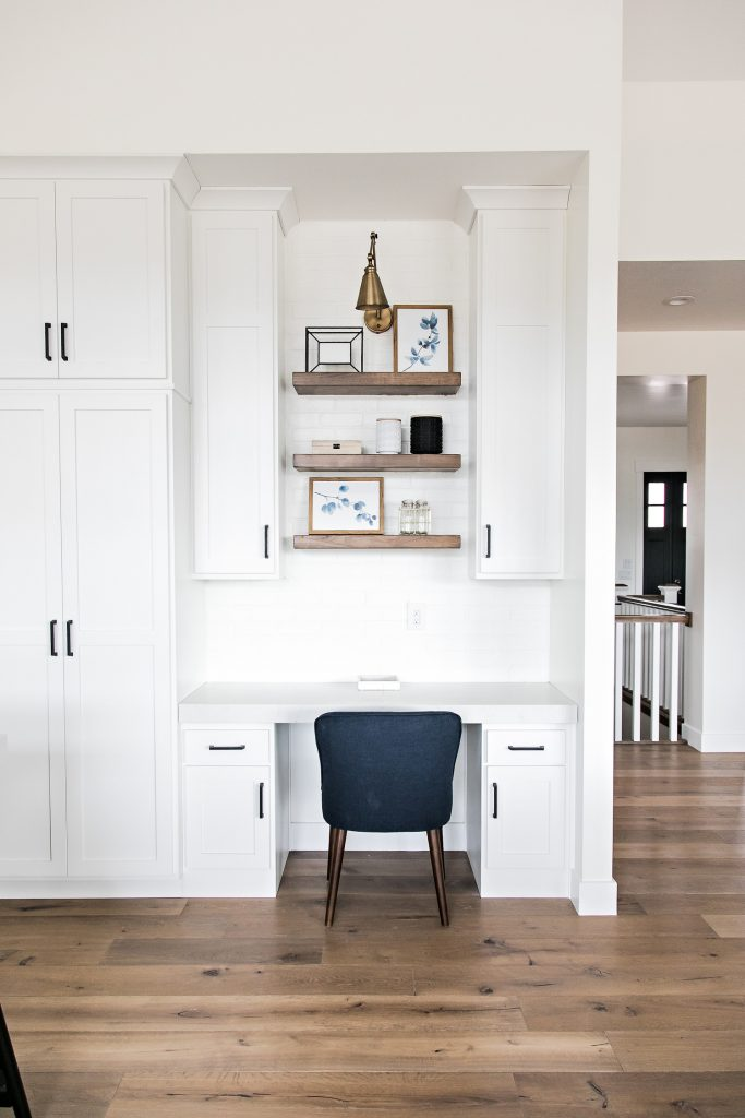 a kitchen desk with open shelving