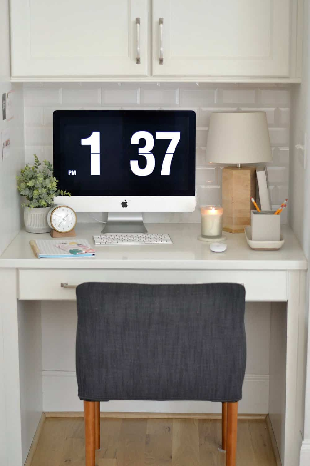 kitchen desk with computer and lamp