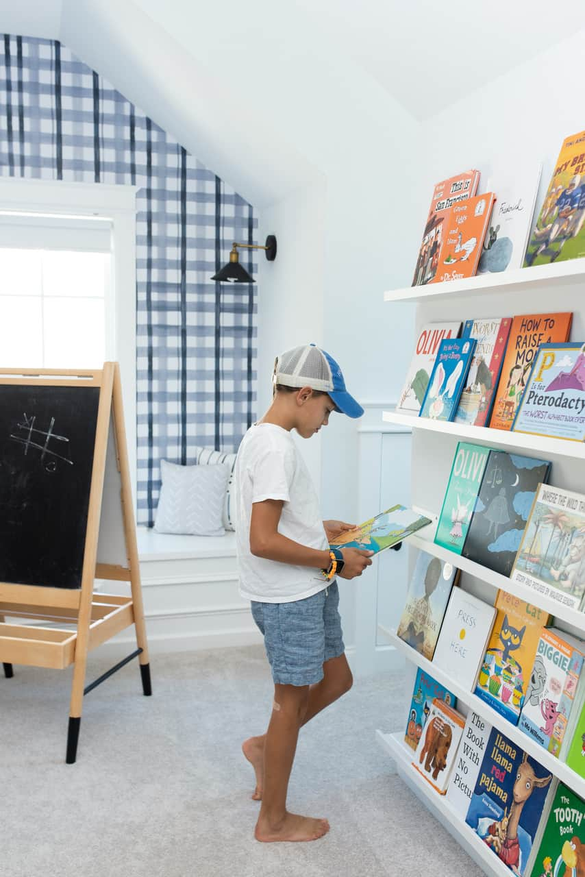 boy reading book in a playroom