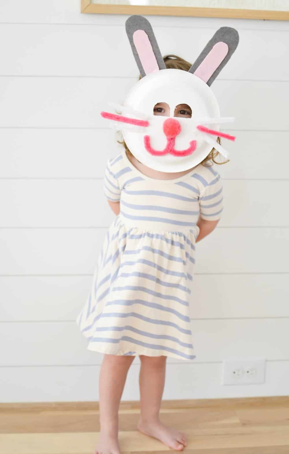 a girl wearing easter bunny mask