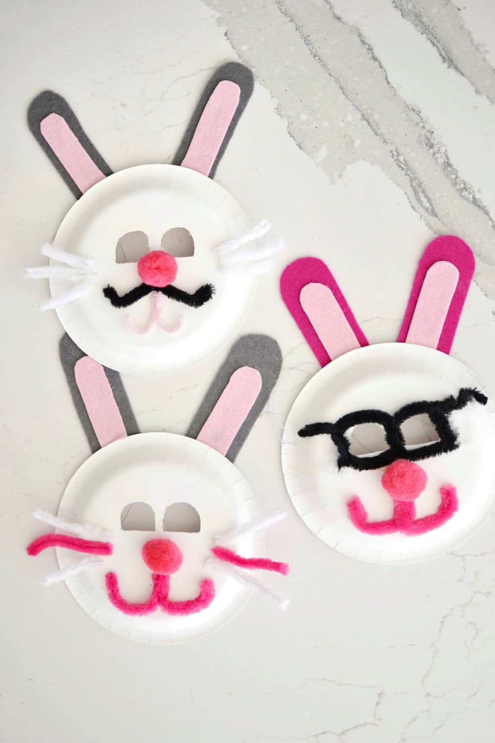 3 easter bunny masks on a counter