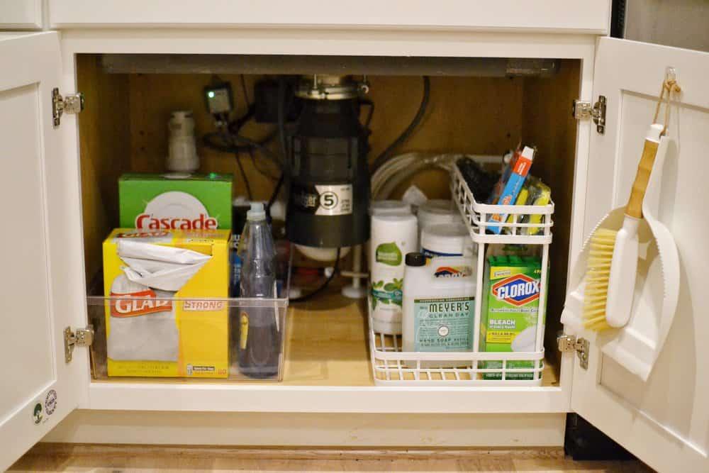 caddies under the sink in a walk in pantry