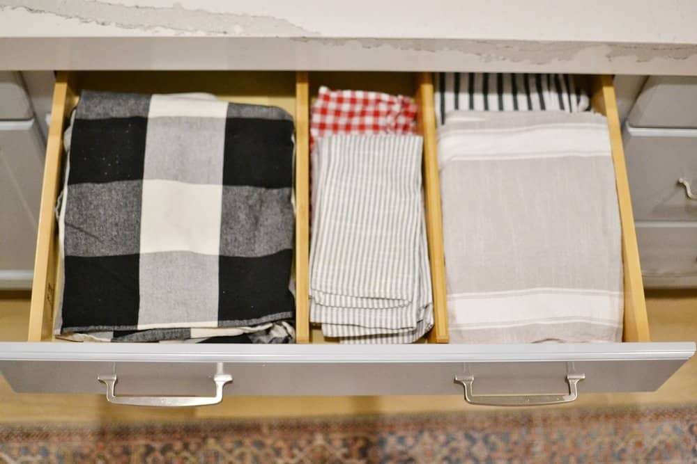 tablecloths in an organized drawer with bamboo drawer organizer