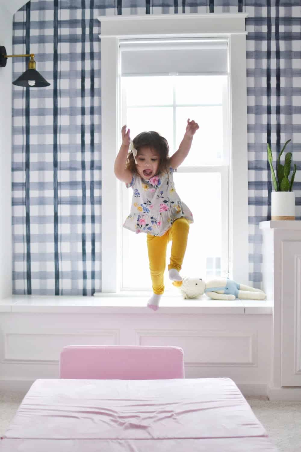 built ins in the playroom toddler jumping