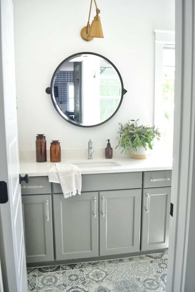 Mixing metals in bathroom with patterned tile