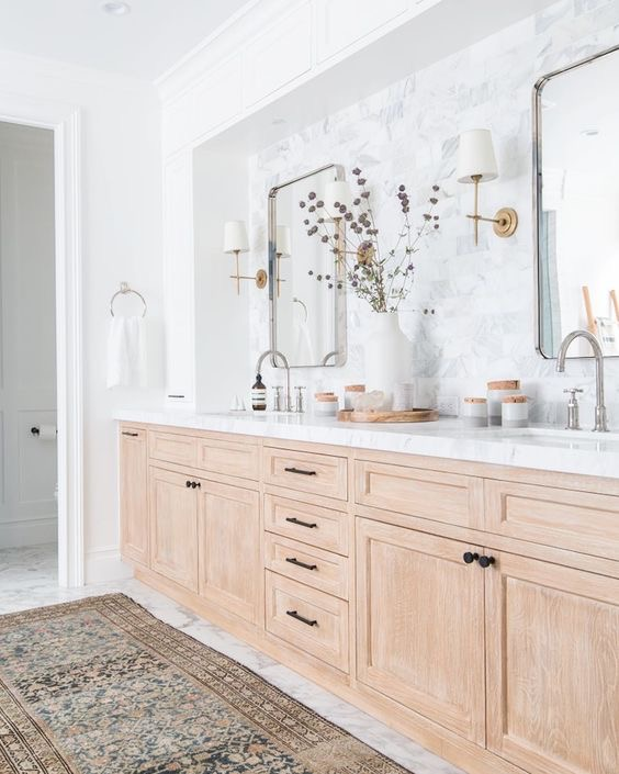 wood cabinets in a bathroom with mixed metals