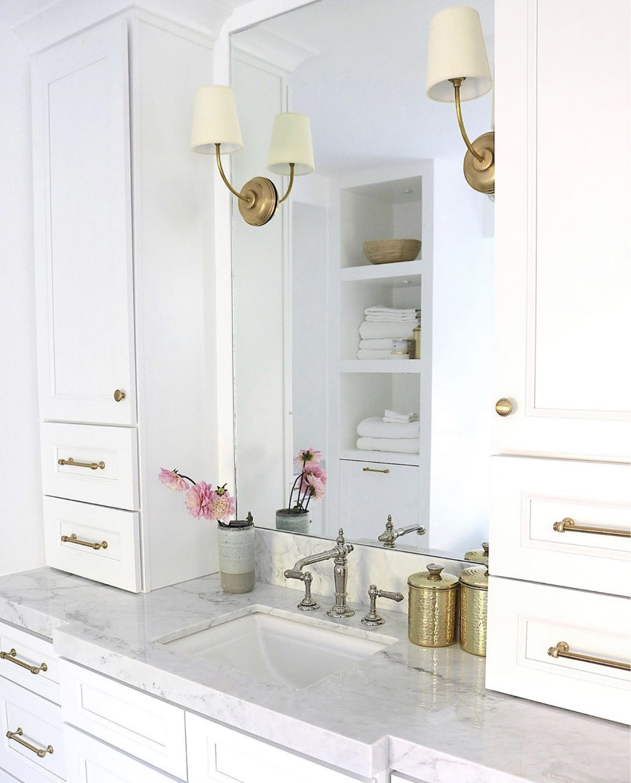 brass and nickel metals used in a bathroom with marble countertop