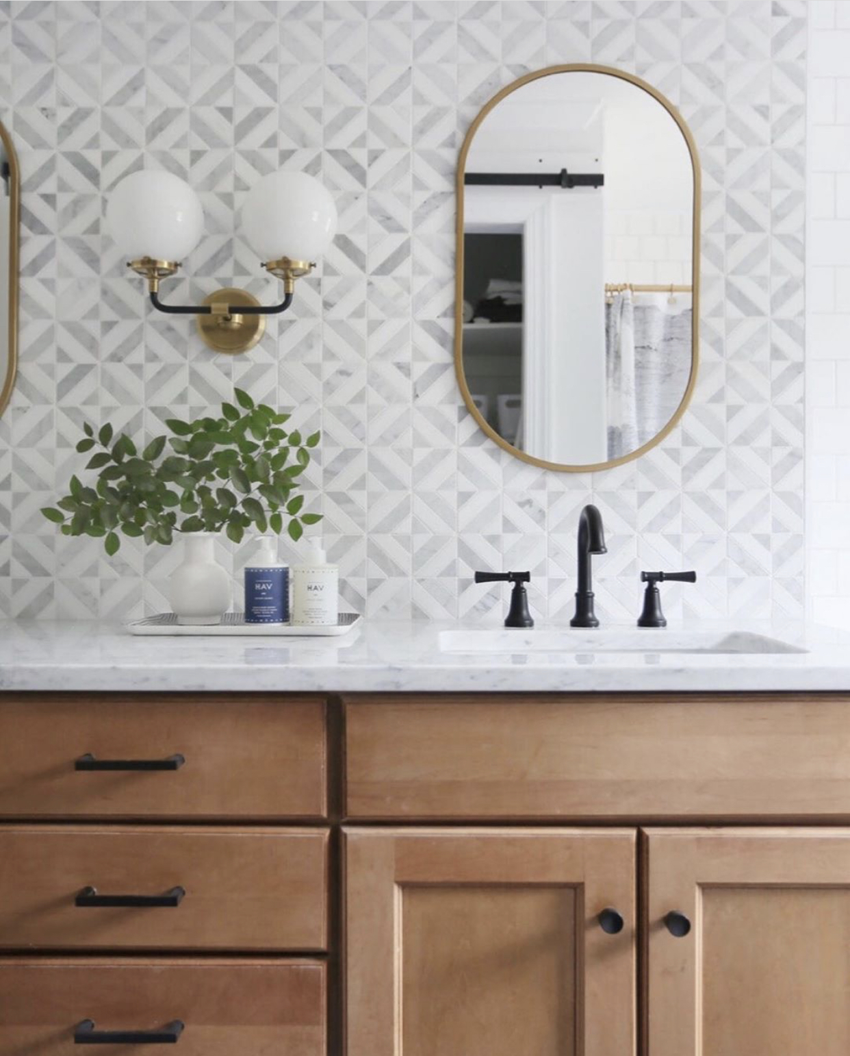 bathroom with brass and black mixing metals