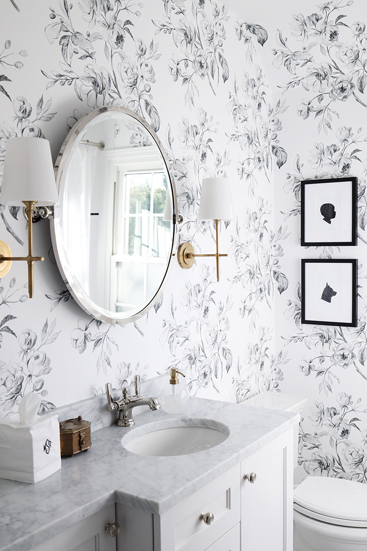 a black and white bathroom mixing metals