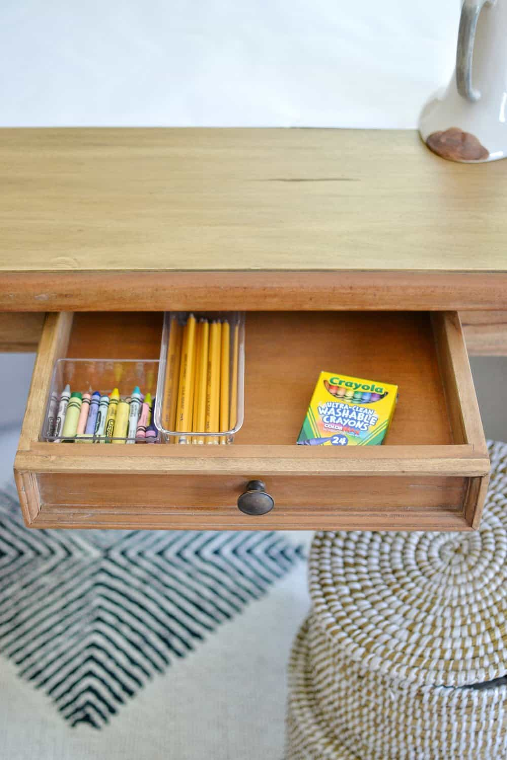 open drawer in a desk with pencils inside