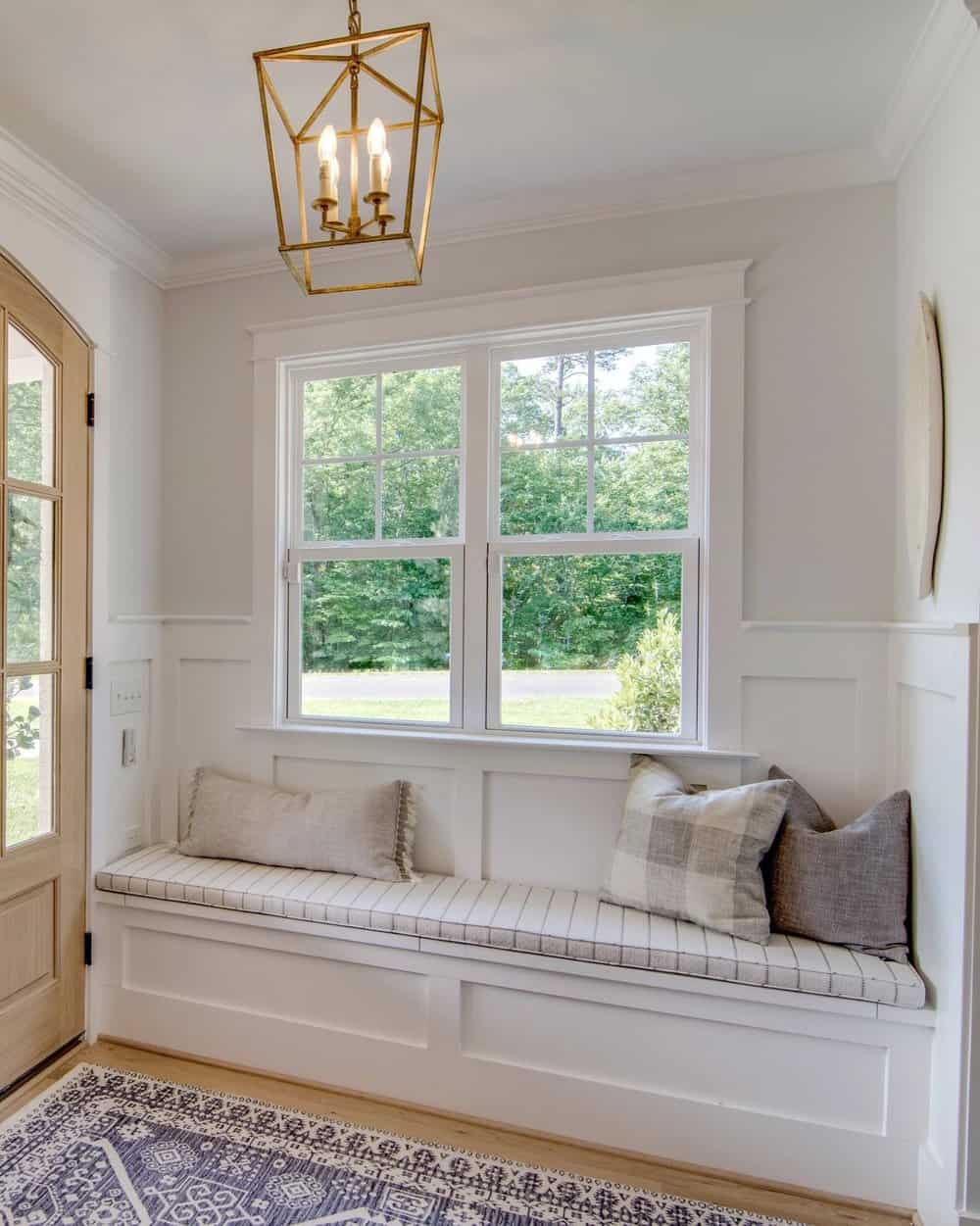 entry with built in bench and brass darlana light