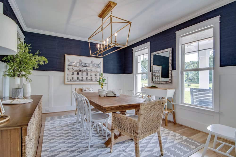 navy dining room with a table and 8 chairs