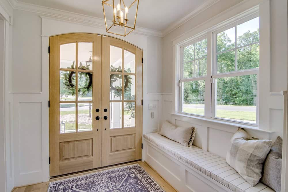 double doors and a window seat in entry