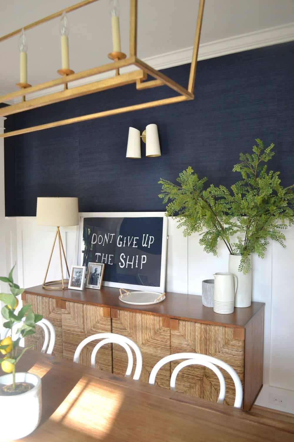sideboard in a navy dining room
