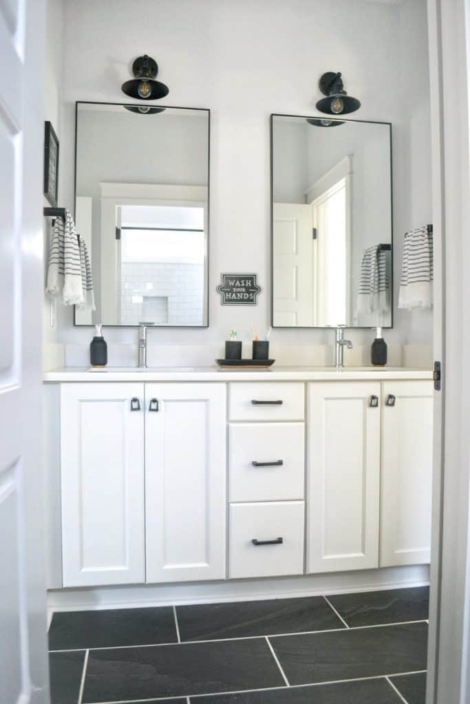 double vanity black and white bathroom