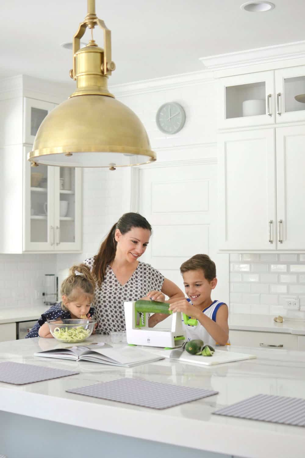 2 kids and a mom cooking in kitchen using a kitchen item bought at Home Centric