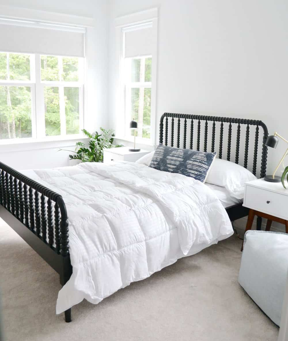 black Jenny Lind bed with a home centric blanket