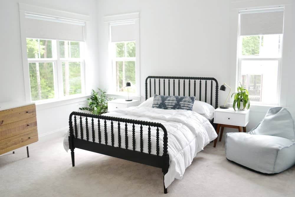 bed with a down comforter on top from home centric