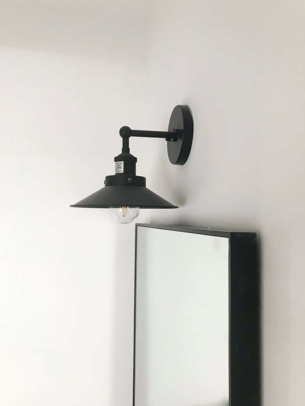 close up shot of black industrial bathroom sconce