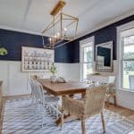 dining room with navy grasscloth wallpaper