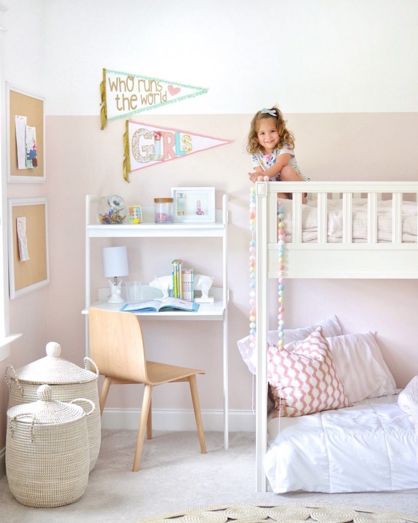 little girl on top of bunk bed
