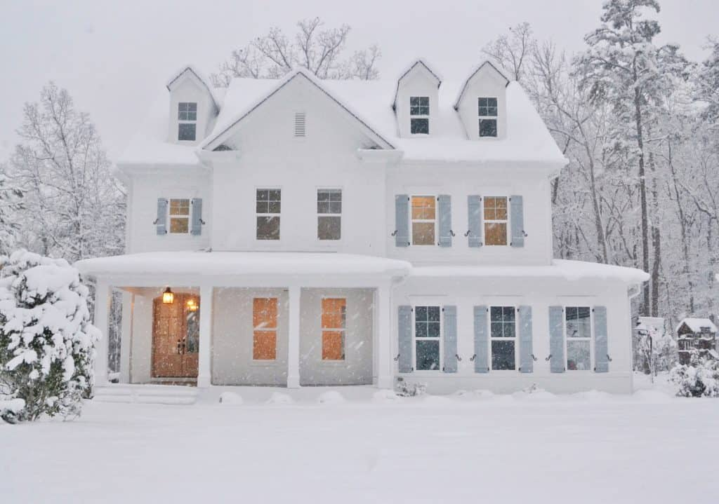 house in the snow painted with Sherwin Williams extra white