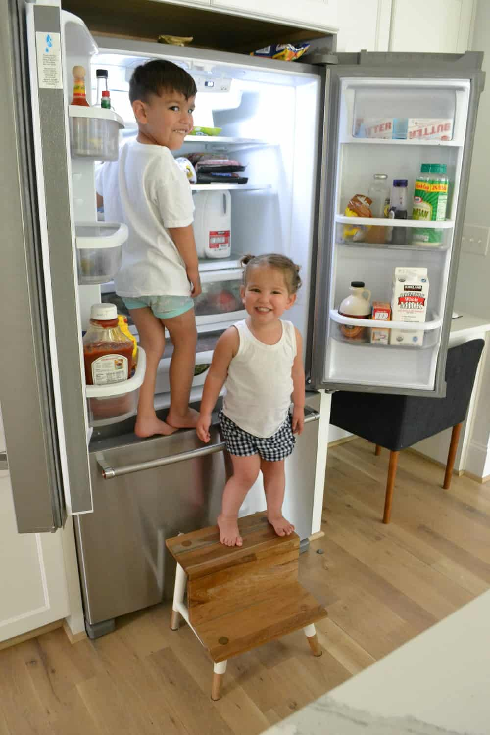 life hacks with 2 toddlers climbing into a fridge