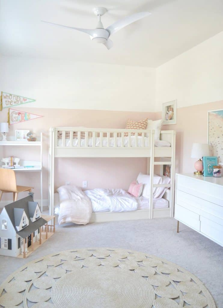 a little girls room with bunk beds