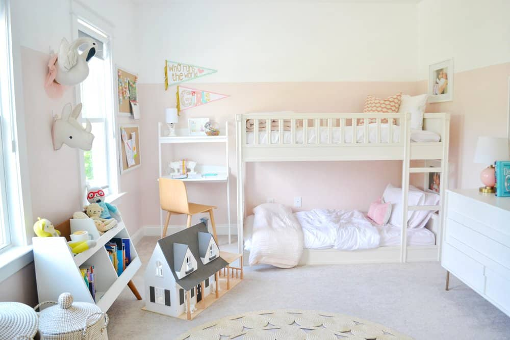 a little girls room shared with pink walls