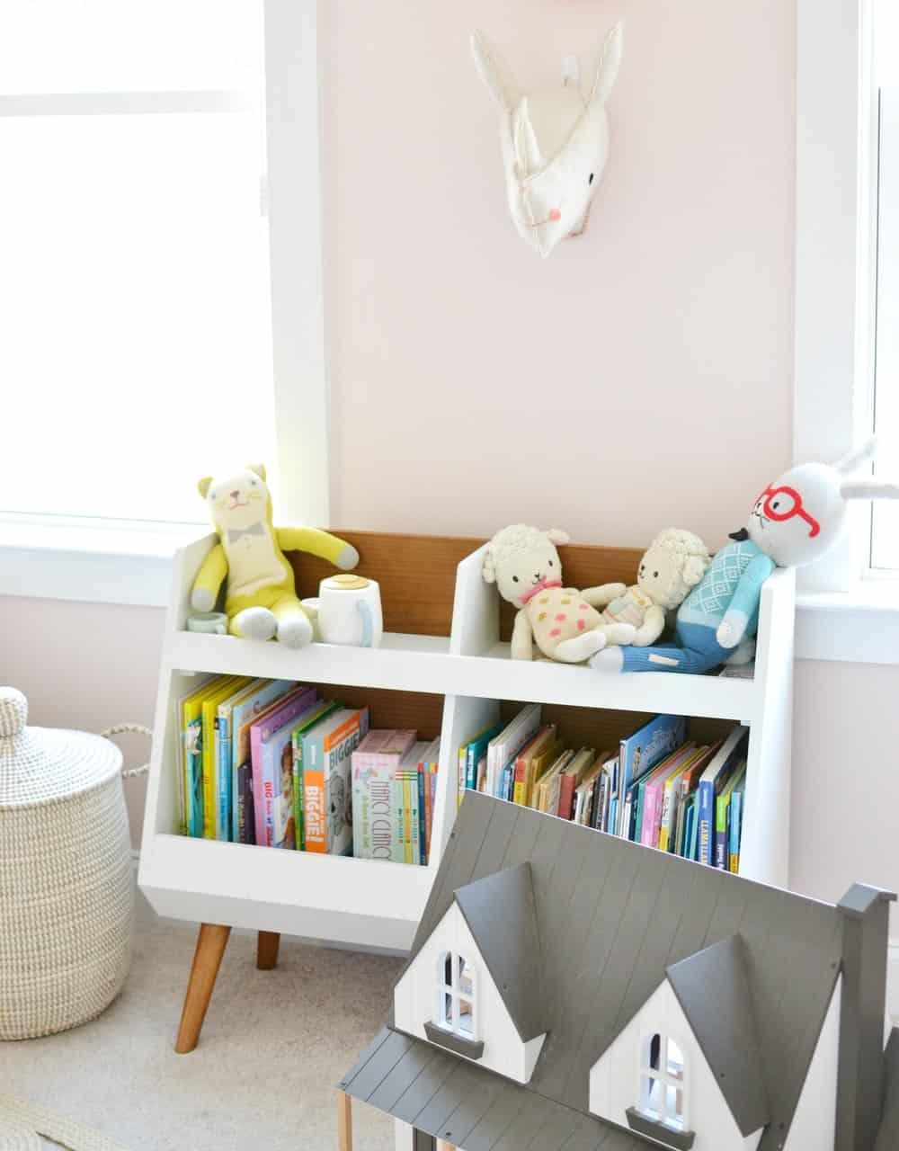 bookshelf in girls shared bedroom