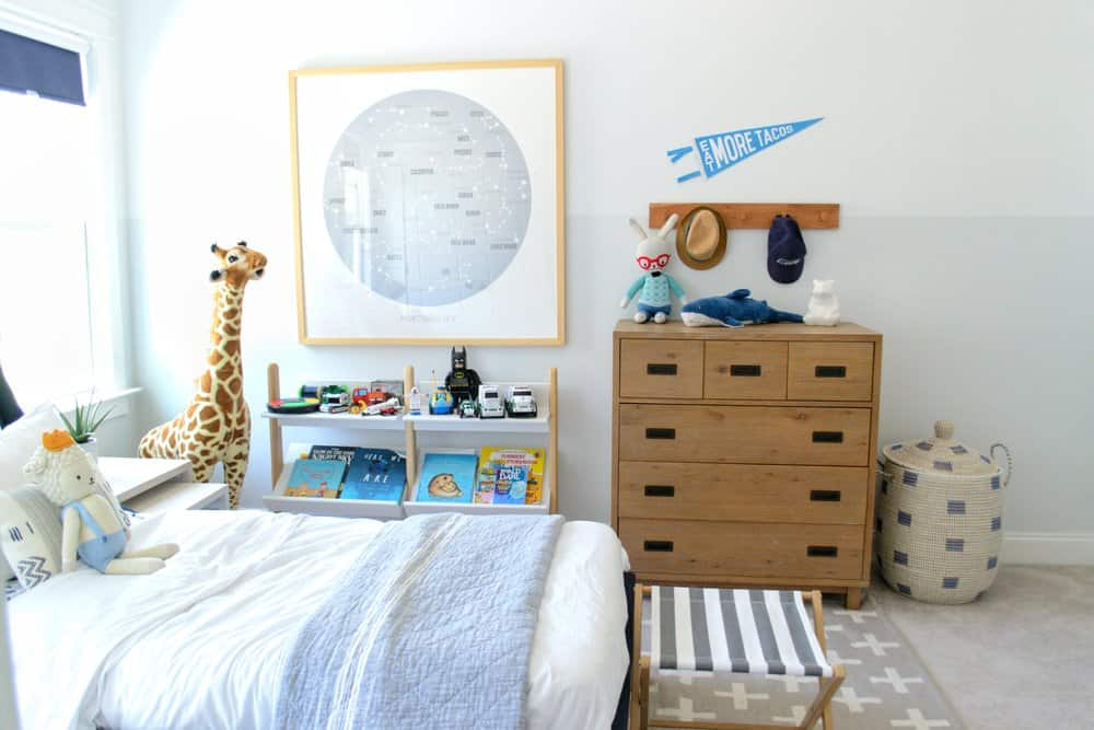 art and two tone walls in a bedroom - gray and white paint