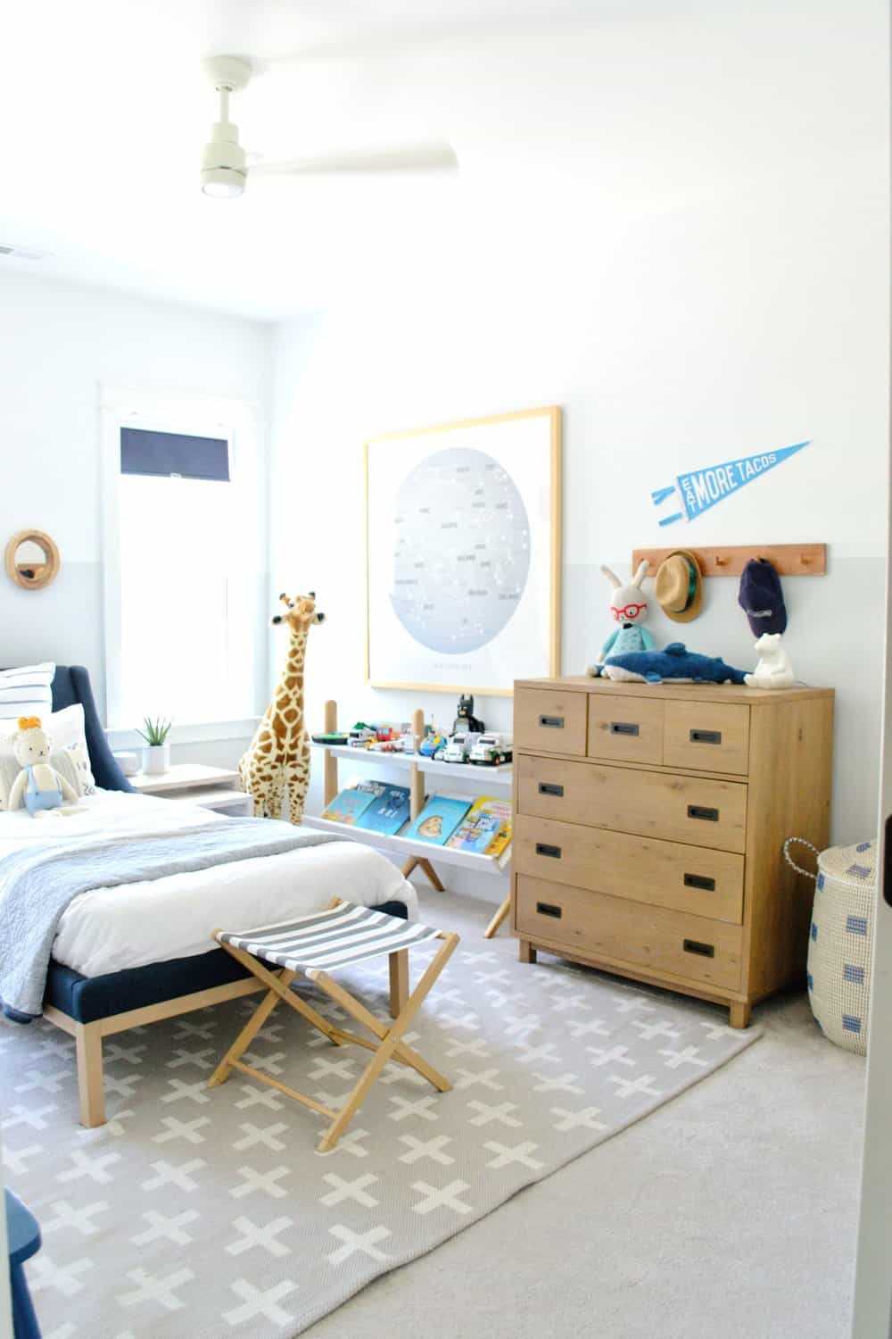 two tone walls in bedroom with children's art up