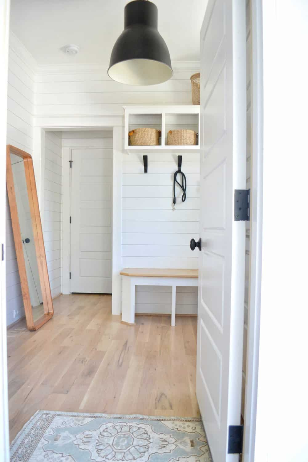 statement lighting in the organized mudroom with shoe organization