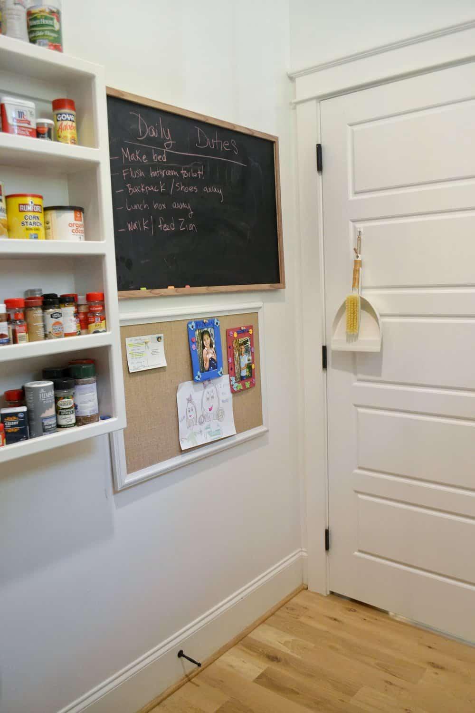 chalkboard and bulletin board in walk in a organized walk in pantry