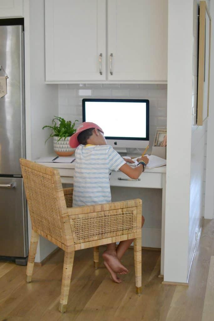 boy at kitchen desk working