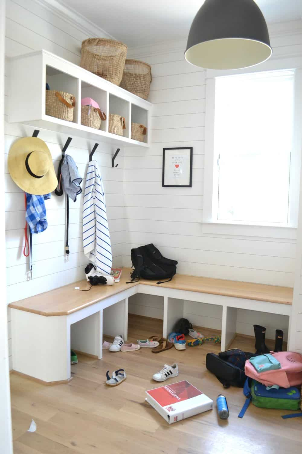 mudroom that needs organizing for back to school