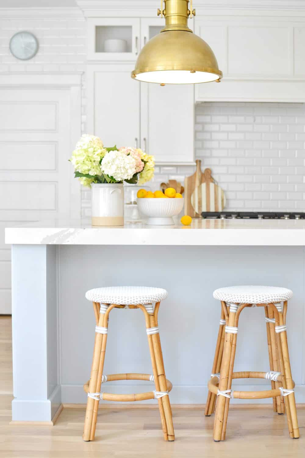 stools and kitchen pendant light in a coastal kitchen design