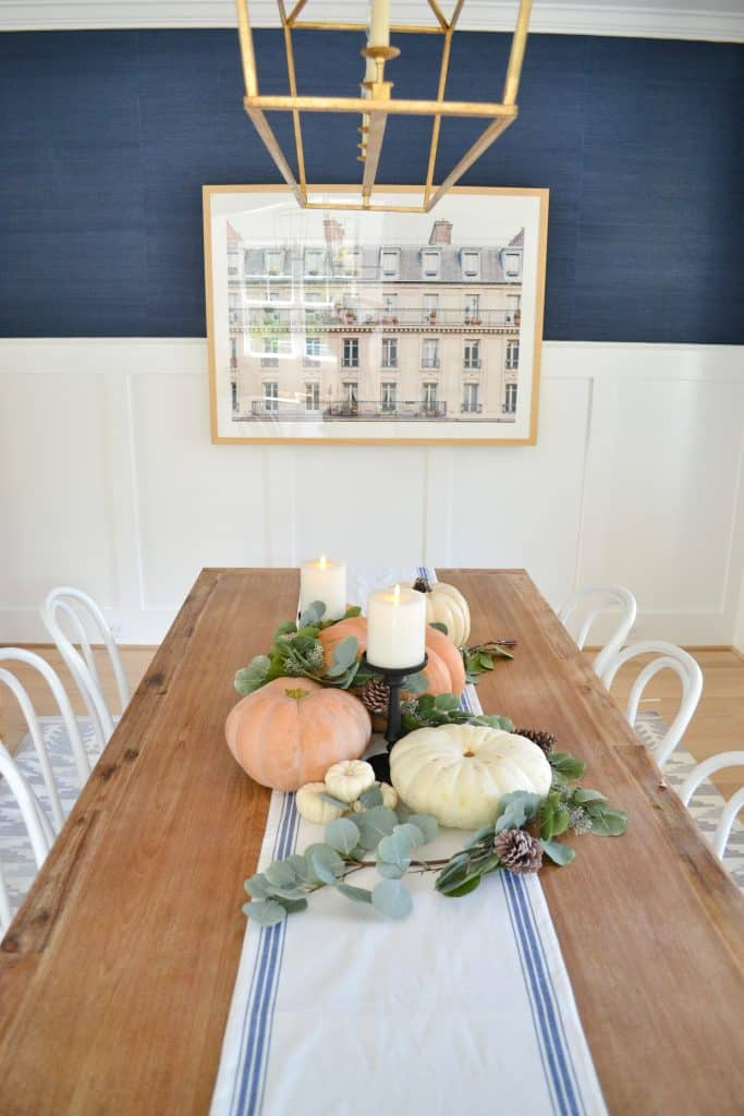 dining room table with pumpkins and navy fall decor