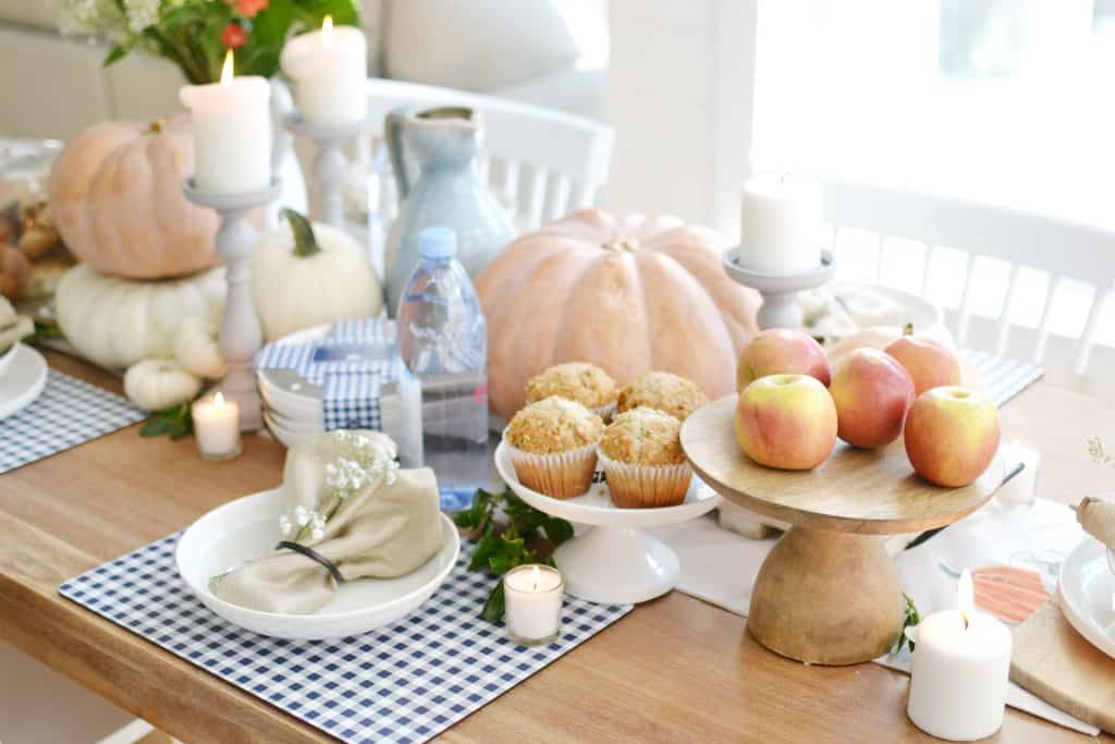 pumpkins and fall decor on a table for fall entertaining