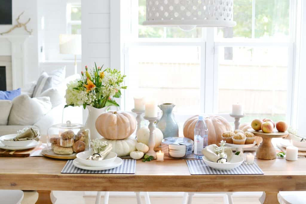 a fall tablescape covered in pumpkins